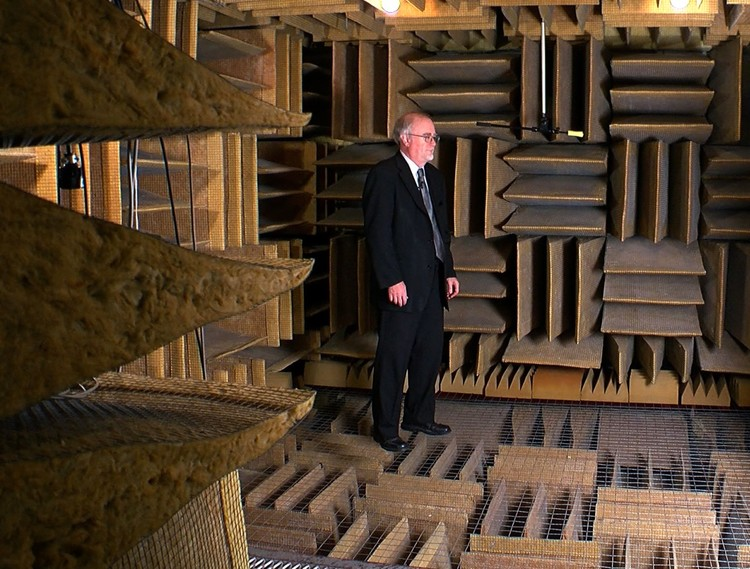 Steven J Orfield in his anechoic chamber at Orfield Labs, which has been certified by Guinness World Records as the quietest place on earth. Image via screenshot from <a  data-cke-saved-href=